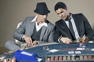 Two gamblers timing the market
