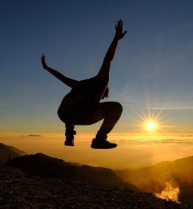 Man jumping at sunrise