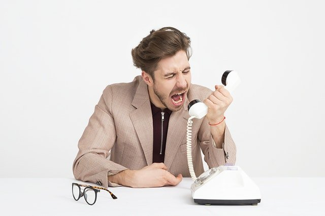 Angry Parent Yelling Into Phone